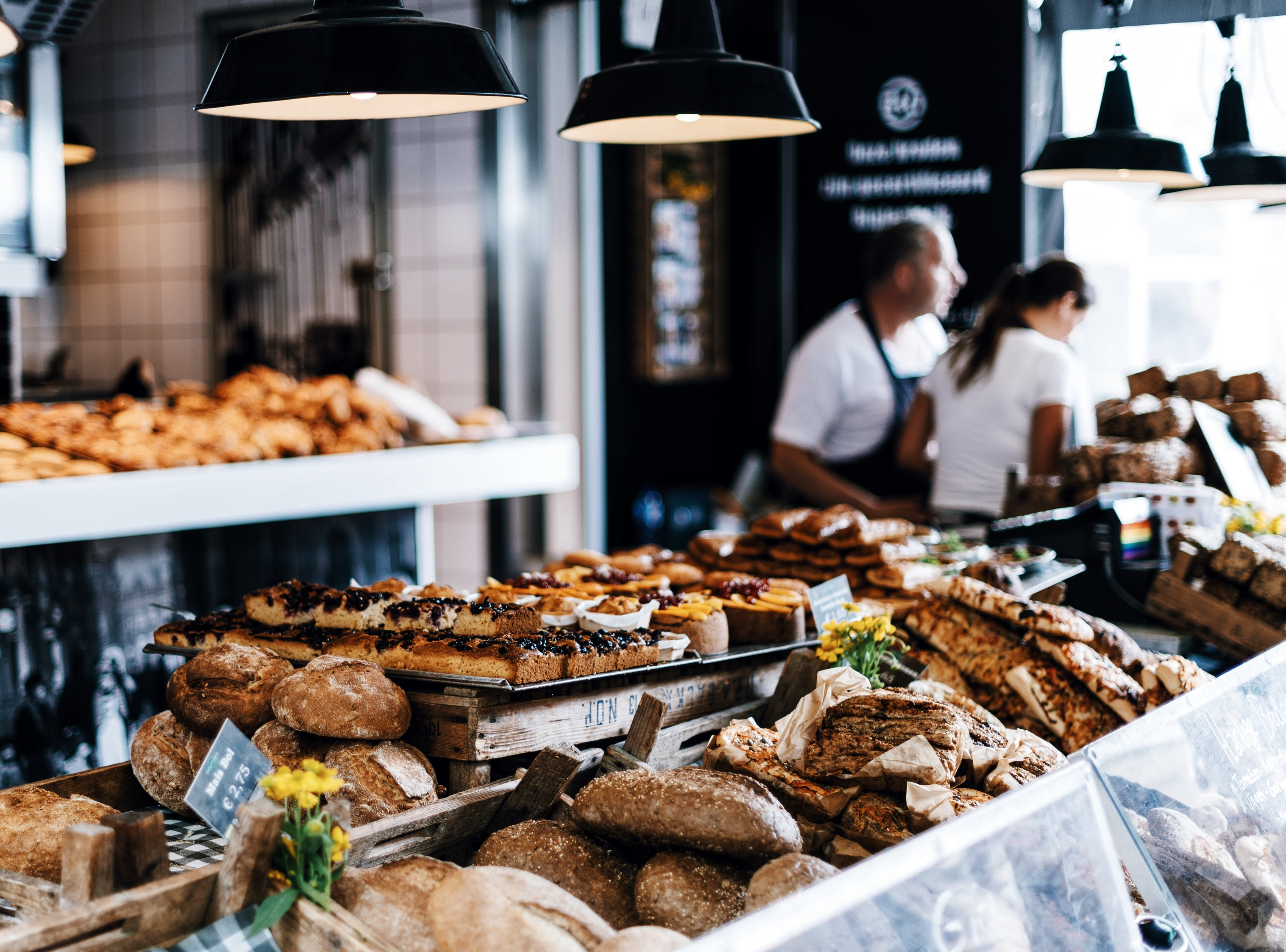 An assortment of pastries and breads on display at a bakery.