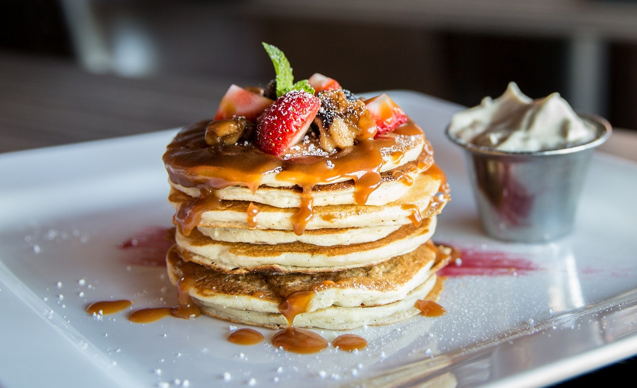 a stack of pancakes with caramel syrup