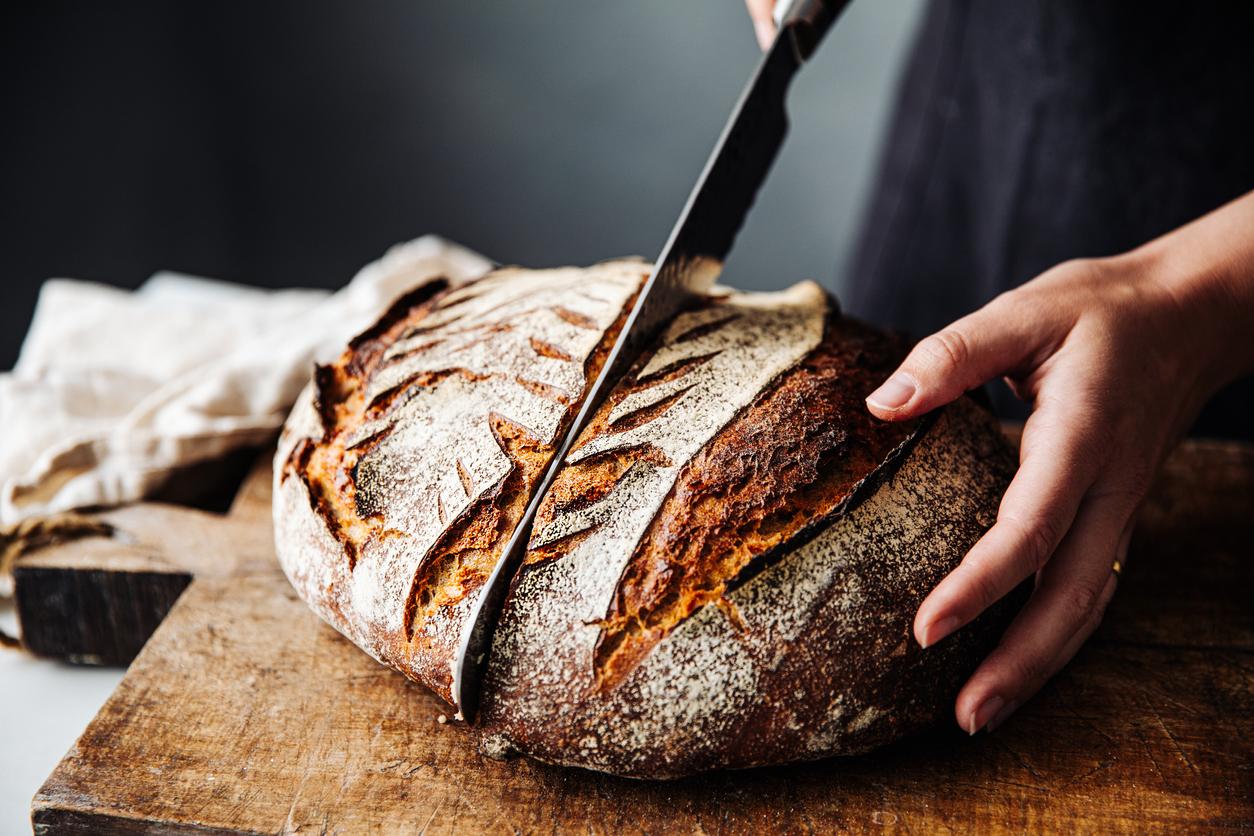 cutting artisan bread on board