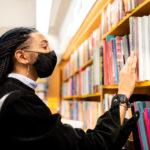 A man browsing the selection | local bookstores in Arlington, VA