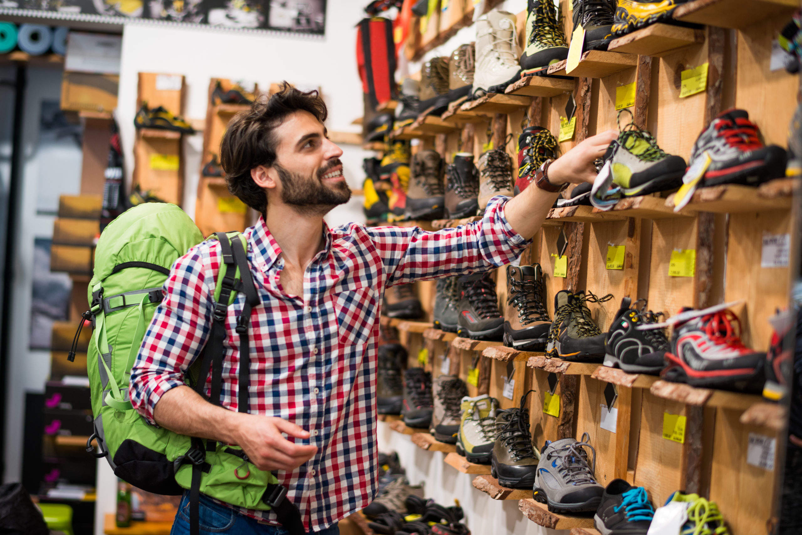 Man shopping for hiking boots | sporting goods stores in Arlington, VA