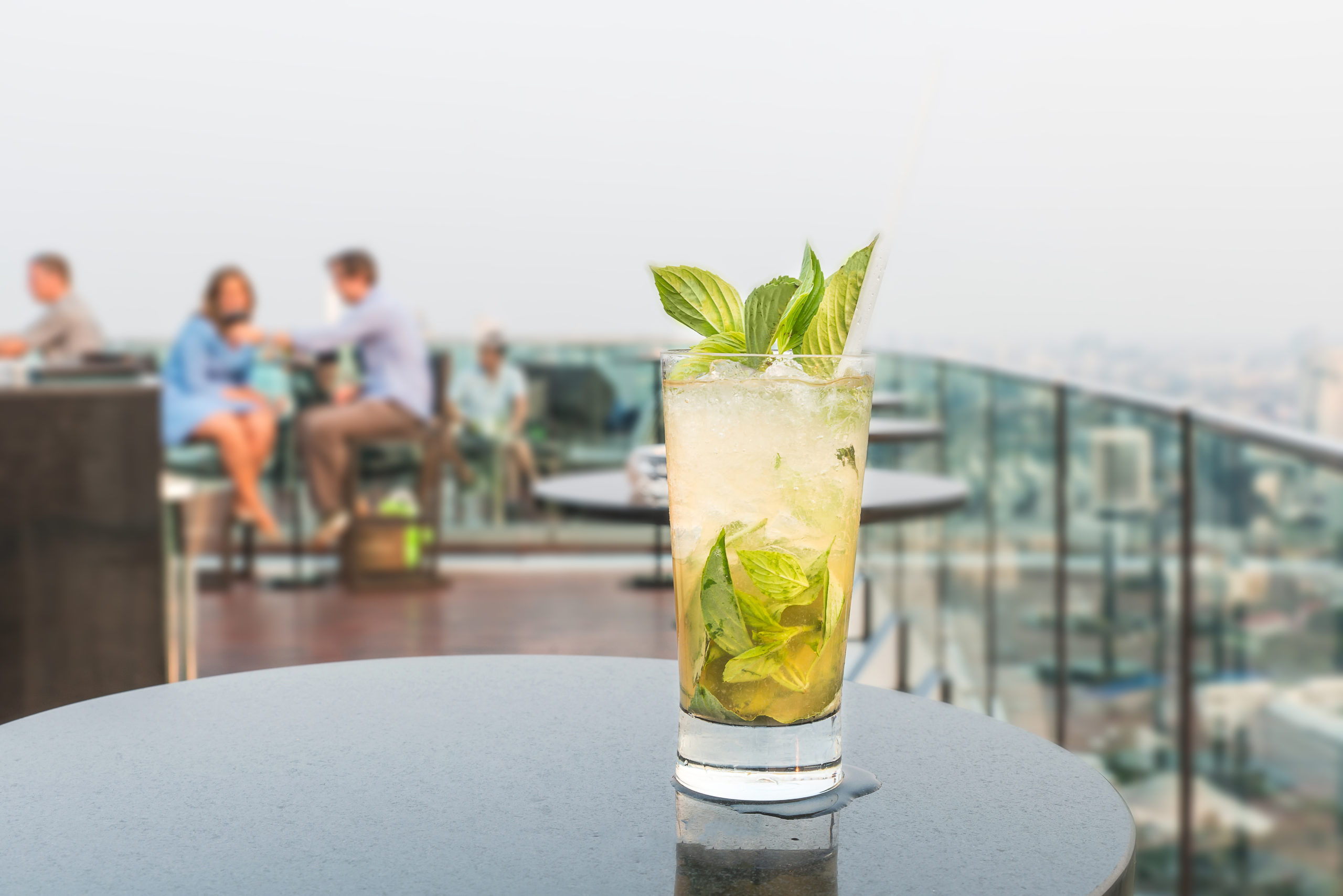 mojito on a table on a roof | rooftop bars in Arlington, VA